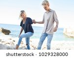mum and teenager son walking... | Shutterstock . vector #1029328000