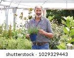 portrait of mature man choosing ...   Shutterstock . vector #1029329443