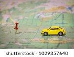 a yellow passenger car travels... | Shutterstock . vector #1029357640