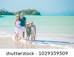 happy family on the beach... | Shutterstock . vector #1029359509