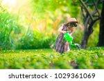 asian little child girl pouring ... | Shutterstock . vector #1029361069