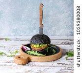 homemade burger in black bun...   Shutterstock . vector #1029380008