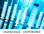 syringes on a turquoise... | Shutterstock . vector #1029381883