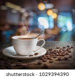 coffee cup and coffee beans on... | Shutterstock . vector #1029394390