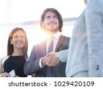businesspeople  shaking hands... | Shutterstock . vector #1029420109