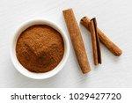 finely ground cinnamon in white ... | Shutterstock . vector #1029427720