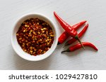 coarsely ground chilli peppers... | Shutterstock . vector #1029427810