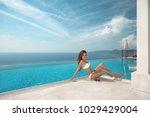 sexy model in white bikini...   Shutterstock . vector #1029429004