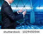 business man touch to mobile... | Shutterstock . vector #1029450544