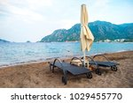 sun loungers on a beach in... | Shutterstock . vector #1029455770