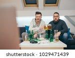 friends watching sport on tv at ... | Shutterstock . vector #1029471439