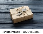 gift box wrapped in kraft paper ... | Shutterstock . vector #1029480388