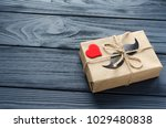 gift box wrapped in kraft paper ... | Shutterstock . vector #1029480838