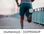 cropped image of a man running... | Shutterstock . vector #1029503629