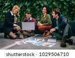 group of coworkers having a... | Shutterstock . vector #1029506710