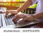 freelance woman's hands on the... | Shutterstock . vector #1029514390