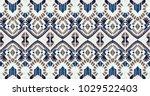 ikat geometric folklore... | Shutterstock .eps vector #1029522403