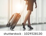 business woman traveling with... | Shutterstock . vector #1029528130