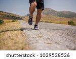 young man runner running on a... | Shutterstock . vector #1029528526