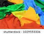 pile of colorful silk fabrics.... | Shutterstock . vector #1029553336
