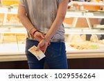 woman customer is buying in the ... | Shutterstock . vector #1029556264