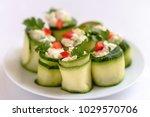 rolls of zucchini stuffed with... | Shutterstock . vector #1029570706