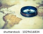 an old compass on vintage world ... | Shutterstock . vector #1029616834