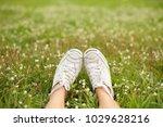 feet in white sneaker on the... | Shutterstock . vector #1029628216