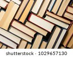 stack of books background. many ... | Shutterstock . vector #1029657130