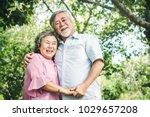 happy elderly couple with...   Shutterstock . vector #1029657208