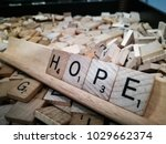 "Small photo of SYDNEY, AUSTRALIA. – On February 20, 2018. - Wooden scrabble tiles letters spelling out the word ""Hope"""