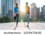 two sporty asian women... | Shutterstock . vector #1029670630