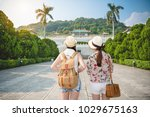 back view of two young asian... | Shutterstock . vector #1029675163