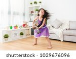little younger daughter playing ... | Shutterstock . vector #1029676096