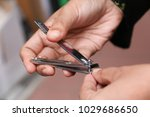 hand cut nails by using nail... | Shutterstock . vector #1029686650