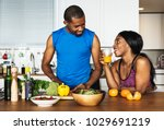 black couple cooking healthy... | Shutterstock . vector #1029691219