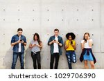 group of young adults outdoors... | Shutterstock . vector #1029706390