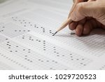 students hand doing exams quiz... | Shutterstock . vector #1029720523
