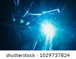 welder in mask welding metal... | Shutterstock . vector #1029737824