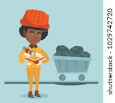 young african miner in hard hat ... | Shutterstock .eps vector #1029742720