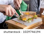 menslicing sandwich on wooden... | Shutterstock . vector #1029746194