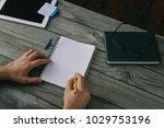 male hands write in a notebook... | Shutterstock . vector #1029753196