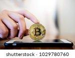 golden metal bitcoin crypto... | Shutterstock . vector #1029780760