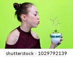 girl holding eco led bulb with... | Shutterstock . vector #1029792139