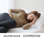 young asian woman in pain with... | Shutterstock . vector #1029800206