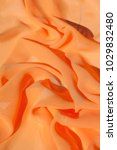 Small photo of Background texture pattern. Silk crepe of chiffon peach peachpuff Introducing the sultry and stunning Silk Satin you see here. Duchess satin is a gorgeous high-fiber count medium-bodied low luster
