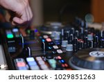 dj working a mixer on a party | Shutterstock . vector #1029851263