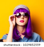 young girl with purple hair and ... | Shutterstock . vector #1029852559