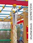 new climbing up sport rope | Shutterstock . vector #1029872554