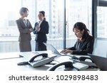three businesswomen working in... | Shutterstock . vector #1029898483